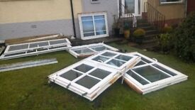 Four UPVC double glazed windows and set of Patio Doors