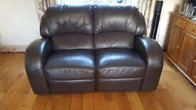 2 seater reclining sofa in brown.