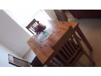 wood dining table and 4 solid wood chairs by John Lewis