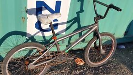 "20"" grey and orange brake-less BMX bike"