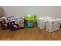 Nappies: lot of 4 packs (inc Pampers) size 4+ /5 - 245 units