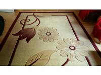 Large creamy & maroon rug