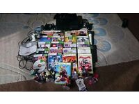 Xbox 360s, 21 games, kinect, disney infinity, 2 wireless controllers, 2 microphones