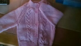 Hand knitted baby cardigans various sizes and colours priced each. Any required colour can be done.