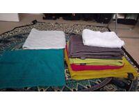 Assorted towels and bath mats