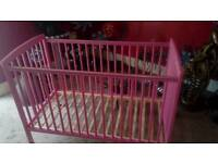 Babies bright pink cot ..as new