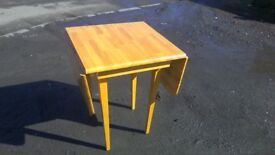 Solid pine drop leaf dining table in good condition, butchers block style top
