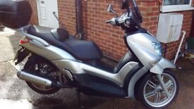 Commuter or leisure bike/scooter. Excellent condition and low mileage with long MOT to March 2019