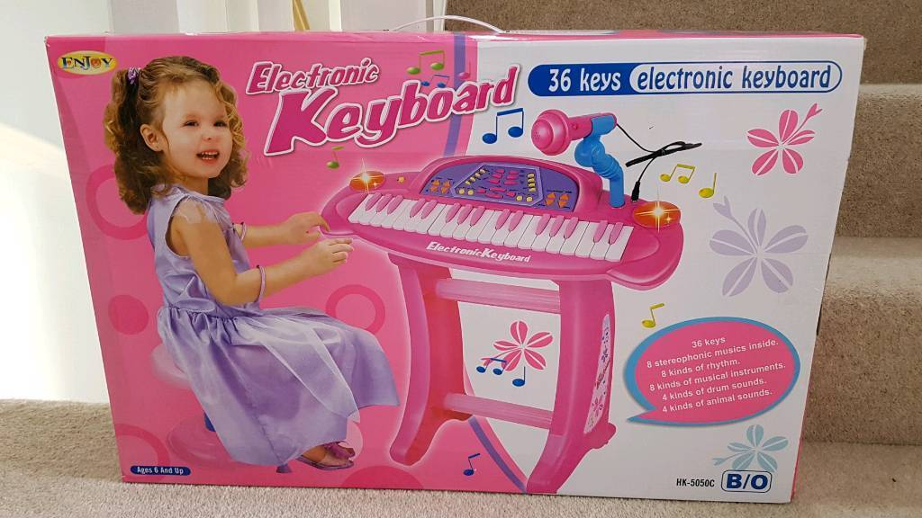 Kids pink keyboard, stool and microphone set. Brand new.