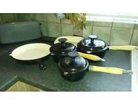 Cast iron saucepans and frying pan set