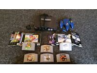 Nintendo 64 console with 1 Controller and 6 games. Mario Kart and mario world and more
