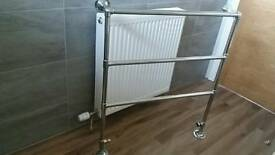 Chrome heated towel rail for gas central heating