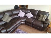 Hearveys reclining faux leather sofa