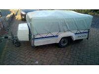Dandy Discovery trailer tent folding camper with a full Dandy awning