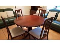 Extending mahogany dining table and four chairs.