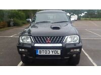 2003 MITSUBISHI L200 WARRIOR 2.5 113 LWB 4WD. CREW CAB WITH 4 DOORS AND FULL LEATHER INTERIOR.
