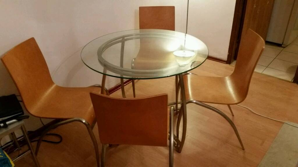 Glass round dining table