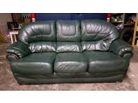 Dark green leather sofa and armchair