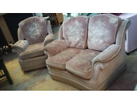 small 2 seater light pink patterned sofa and 1 rocking chair