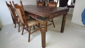 Beautiful wooden table with a set of four chairs