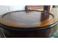 Two circular walnut side tables in excellent condition