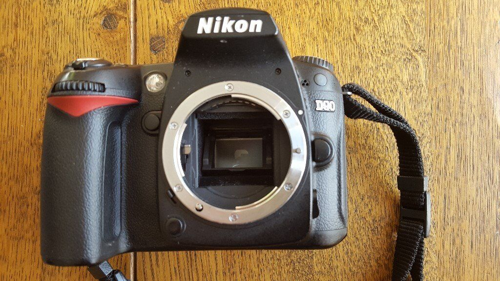Nikon D90 DSLR camera with accessories