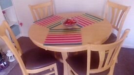 Excellent condition Solid pine table and 4 chairs