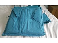 Blue garden tie on seat cushions x 6. Covers can be removed for cleaning. From Marks and Spencers.