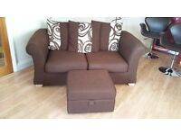 Dark brown sofa bed and matching footstool with storage - very good condition