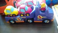 snelcore transport truck with cars