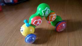 Roll along toy