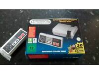 NES mini with extra controller and built in games. Excellent condition. Rarely used.