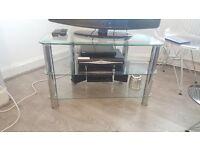 Glass tv stand, chrome legs