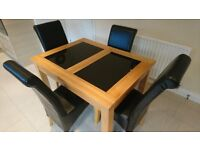 Solid oak and black marble extender dining table and 6 chairs