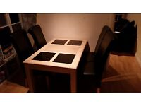 4 seater table wooden table and 4 faux leather chairs