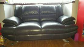 2 seater very dark brown leather sofa with chrome feet