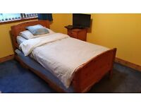 Solid Pine single bed (converts to double) using rollaway second bed