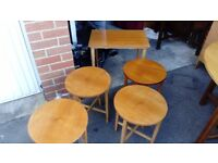 Stunning nest of tables in beautiful condition and on wheels like new perfect rare set very retro