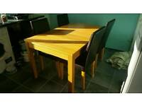 Large extendable dining table and chairs