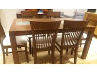 Table with 6 chairs and cabinet
