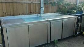 Double sink with four doors tap and hot water heater