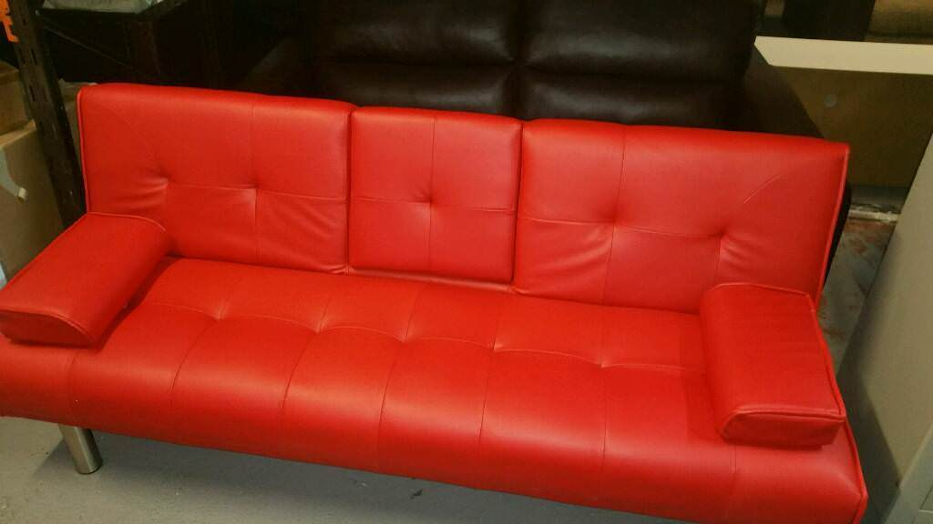 A Brand New Red Leather Effect Click Clack Sofa Bed With Cup Holder Or Bluetooth Connection