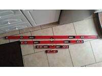 Set of 4 spirit levels 200mm, 600mm, 1200mm and 1800mm in padded carry bag