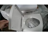 White toilet seat, D shape, straight edges, new unused. plastic. Comes with fixings