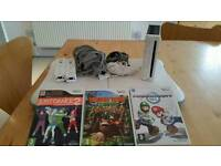 Nintendo Wii with balance board and 3 games