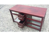 long mahogany wood unit with glass shelves and 2 drawers