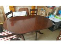 Solid mahogony extendable table with six chairs.