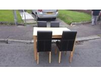 Light oak table and 4 brown leather chairs in very good condition £120