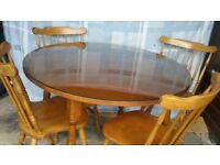 Solid wood table with 4 solid wood chairs. Complete with glass table topper