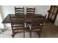 Solid oak refectory table and 4 chairs excellent condition